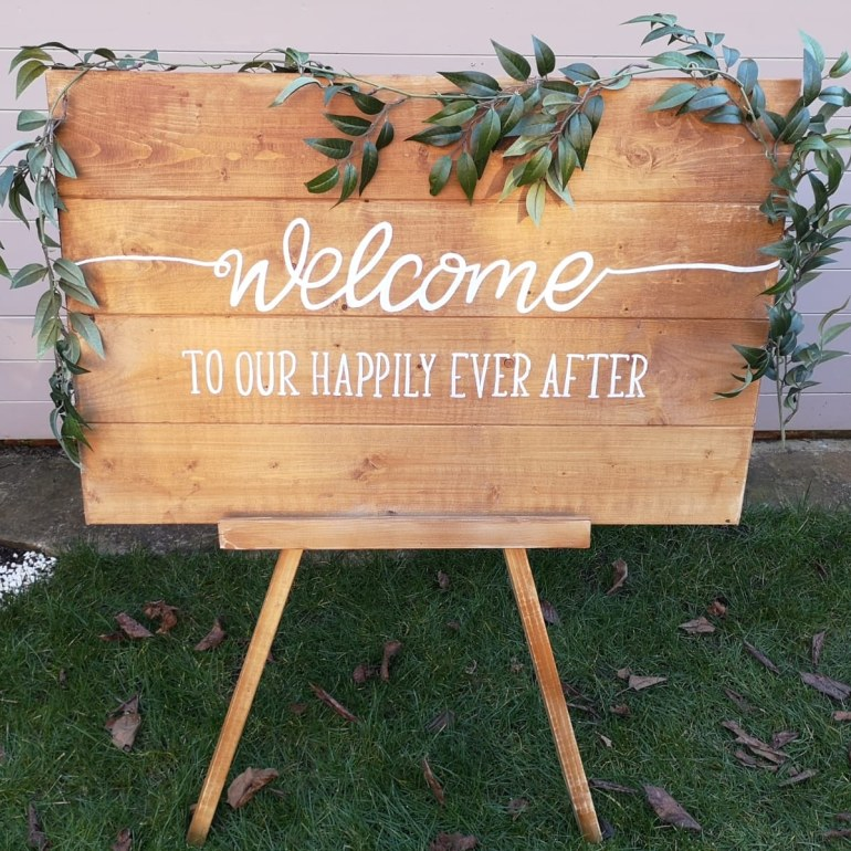 welcome sign and easel
